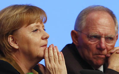German Chancellor and leader of CDU Merkel talks to party fellow and Finance Minister Schaeuble during the CDU's annual party meeting in Hanover