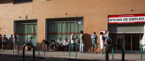 People queue to enter a government-run employment office in Madrid