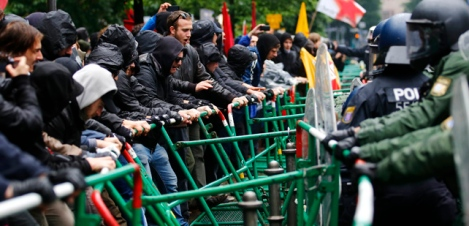 "Riot police try to prevent protestors from breaking through barricades near the ECB headquarters during a ""Blockupy"" demonstration in Frankfurt"