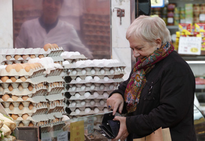 A woman shops at a market in Barcelona